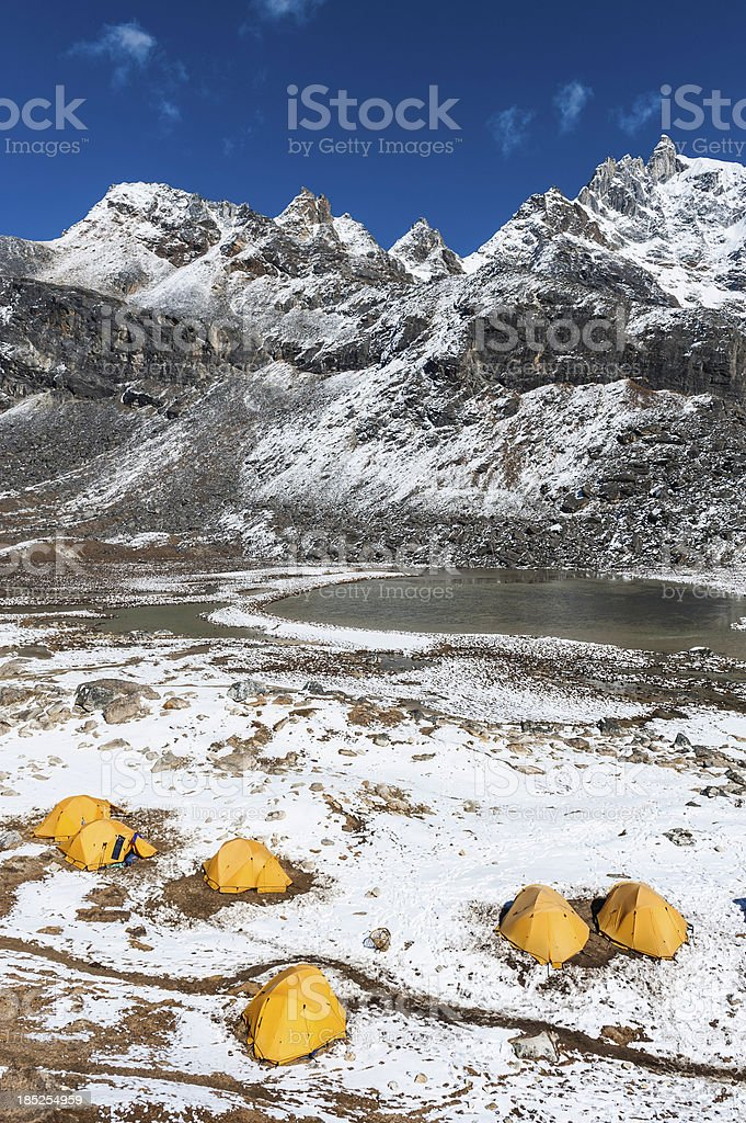 Base camp tents snowy mountain peaks Himalayas royalty-free stock photo
