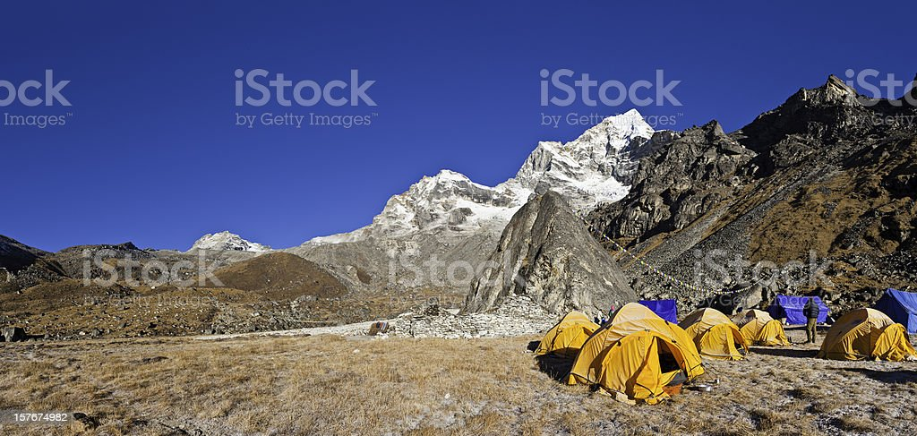 Base camp tents wilderness camping Himalaya mountain peaks panorama Nepal stock photo