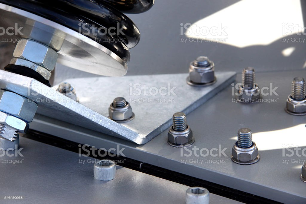 Base of a Wind Turbine, Steel Bolts and Metal Spring stock photo