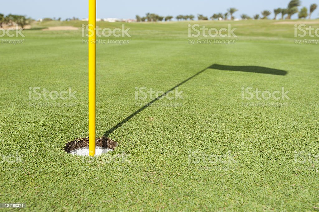 Base of flag pole on golf green royalty-free stock photo