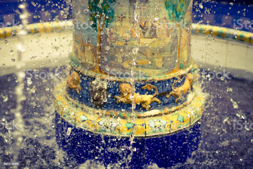 Base of the fountain with the water stopped in time. stock photo