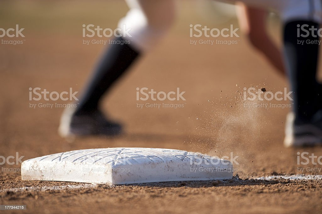 Base with flying dirt stock photo
