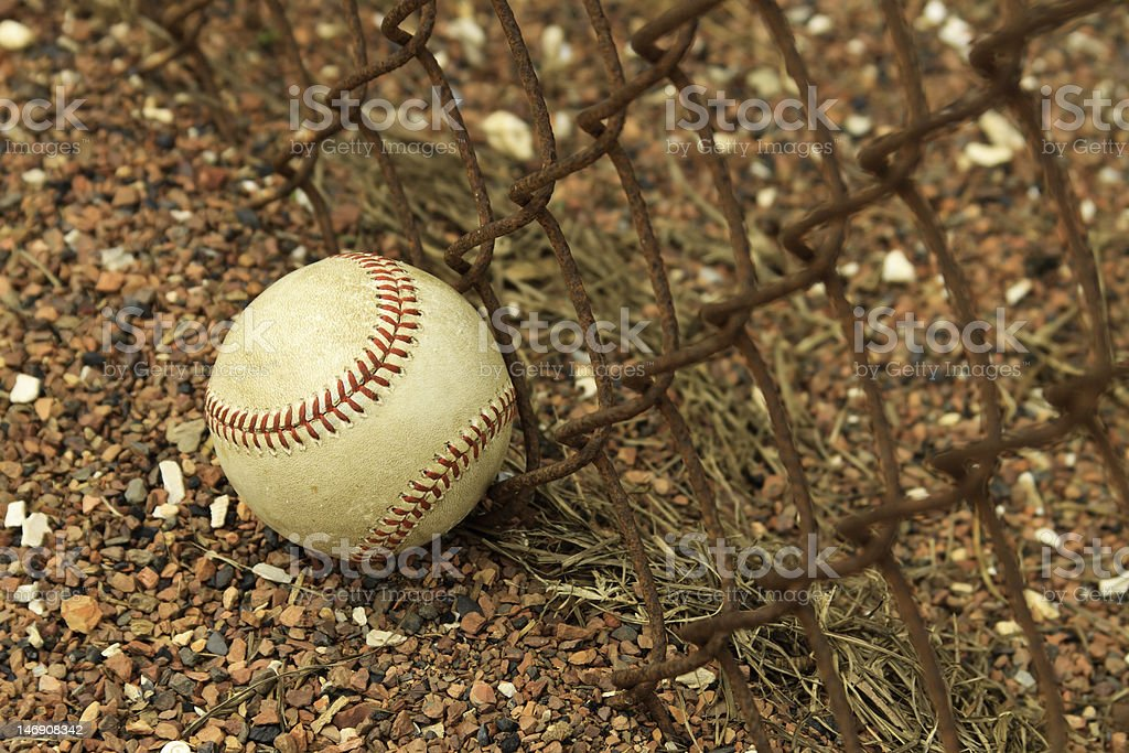 Baseball Against Rusty Fence royalty-free stock photo