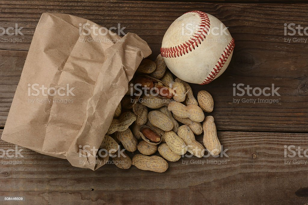 Baseball and a Bag With Peanuts Spilling Out stock photo