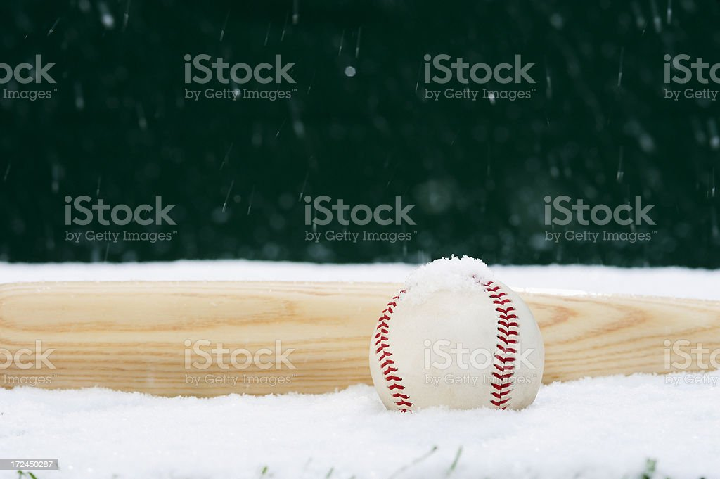 Baseball and Bat in the snow royalty-free stock photo
