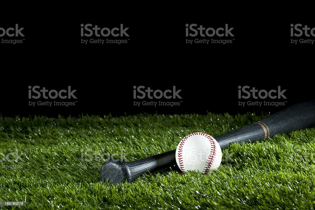 Baseball and bat on the grass stock photo