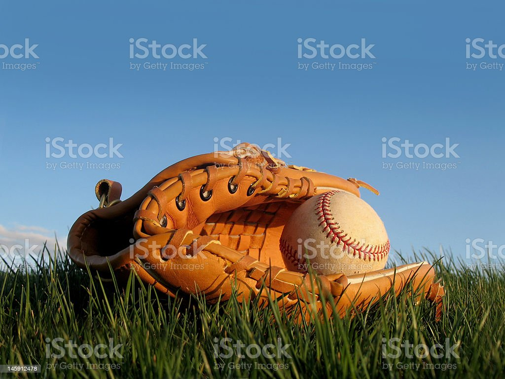 Baseball and Glove in Grass stock photo