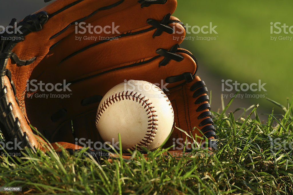 Baseball and glove on the grass stock photo