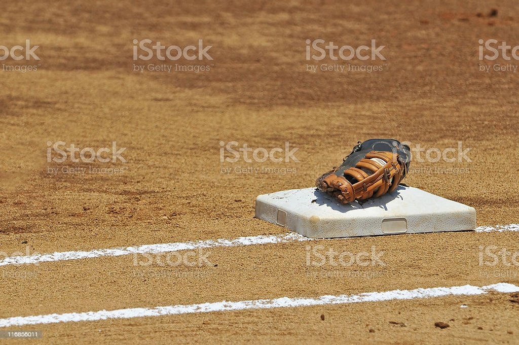 baseball and glove sitting on first base bag royalty-free stock photo