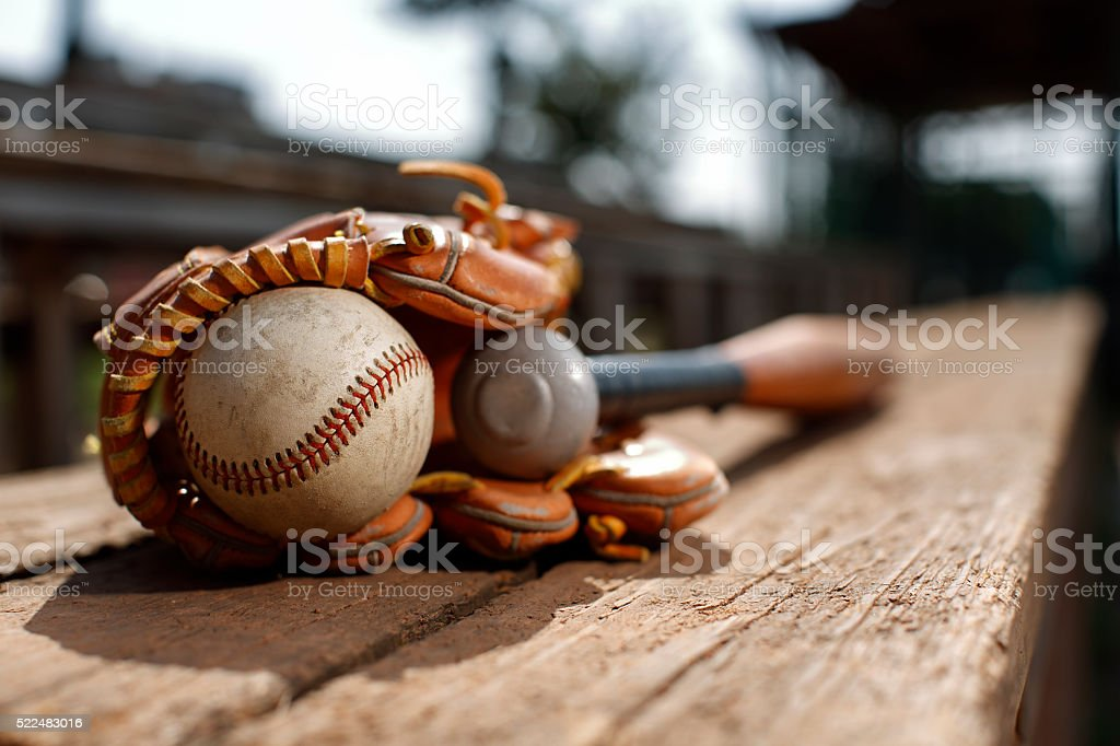 Baseball ball on a bench stock photo