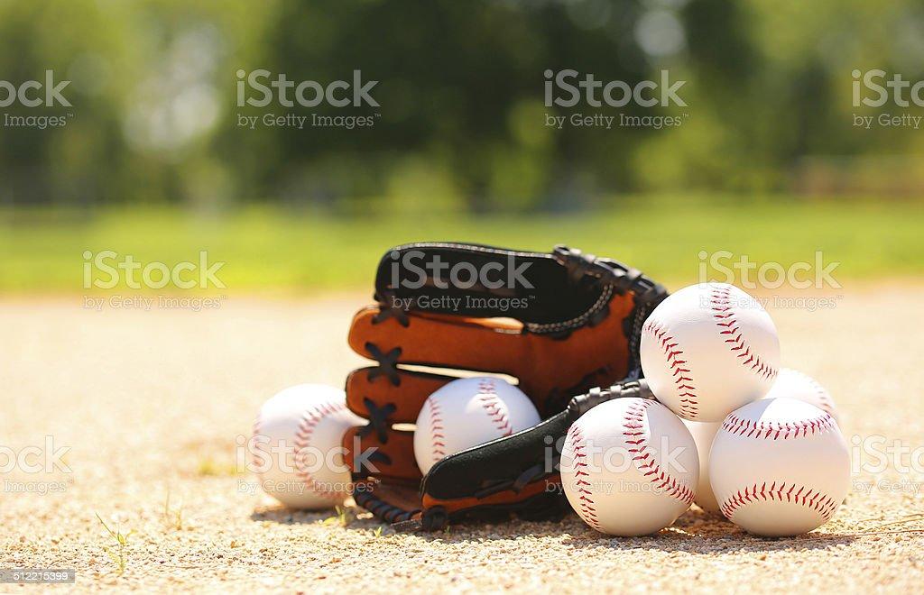 Baseball. Balls and Glove on Field stock photo
