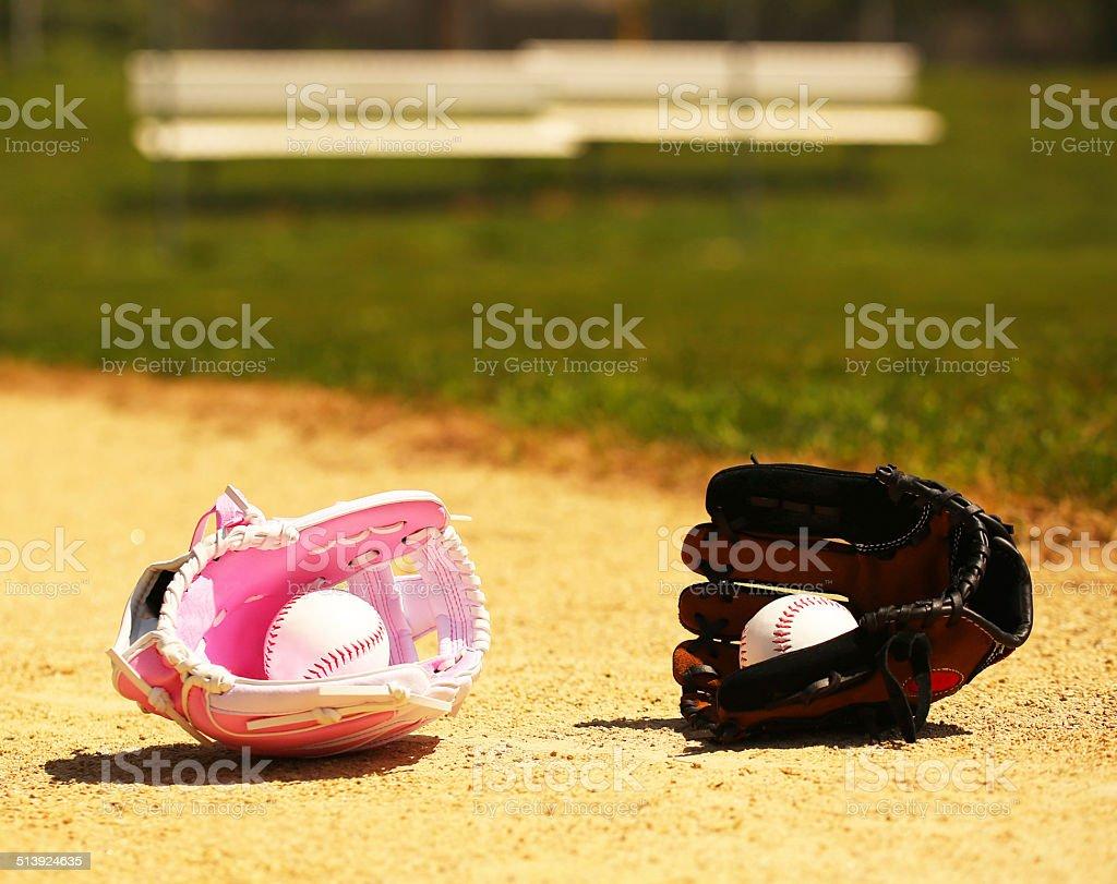 Baseball. Balls in Gloves on Field. Concept stock photo