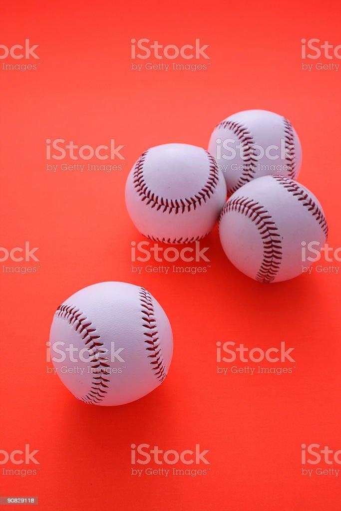 Baseball balls on red background royalty-free stock photo