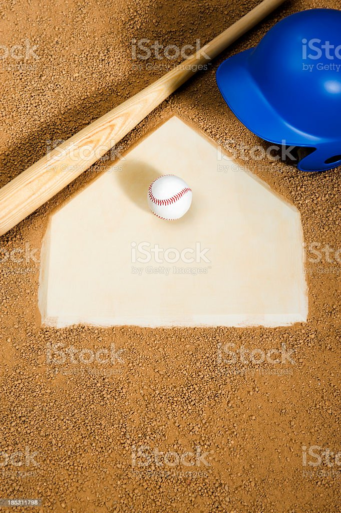 Baseball, bat and batter's helmet on Home Plate stock photo