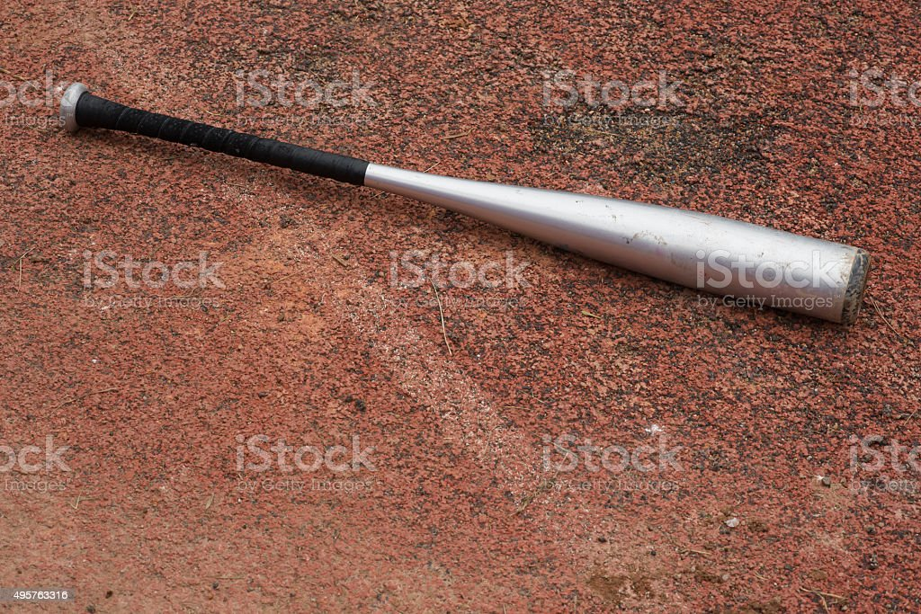 baseball bat on a rubber background stock photo
