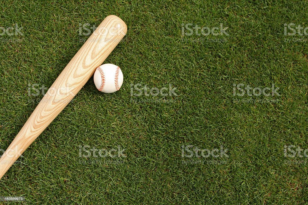 Baseball & Bat on the Grass stock photo