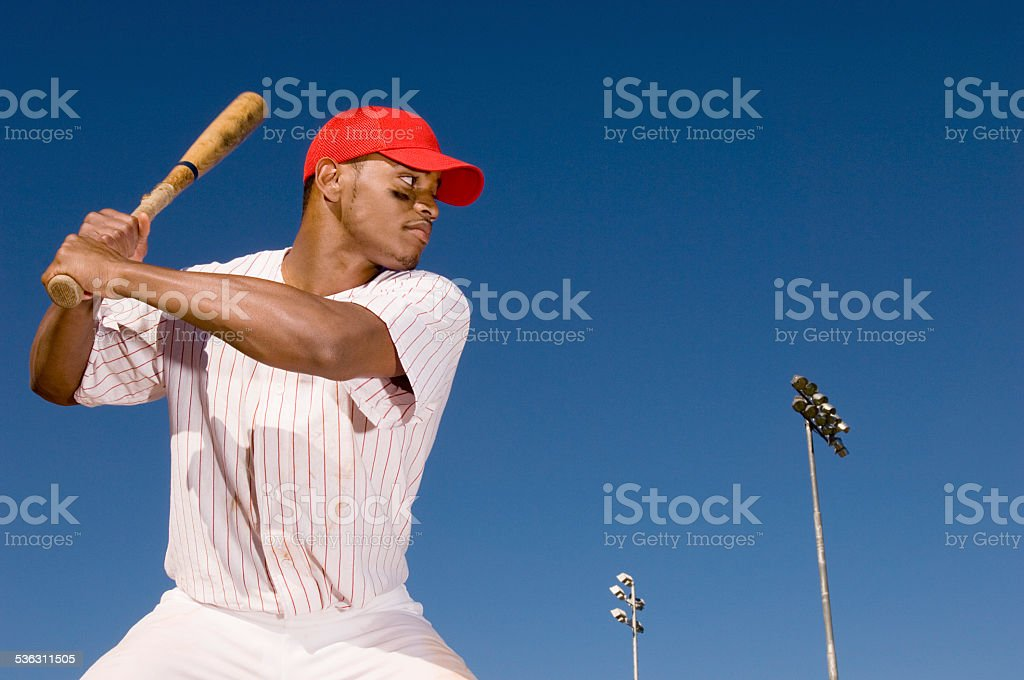 Baseball Batter Preparing to Hit Ball stock photo