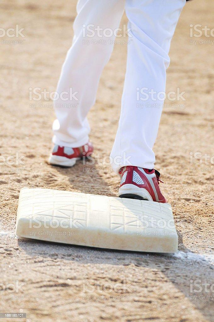 Baseball boy on base stock photo