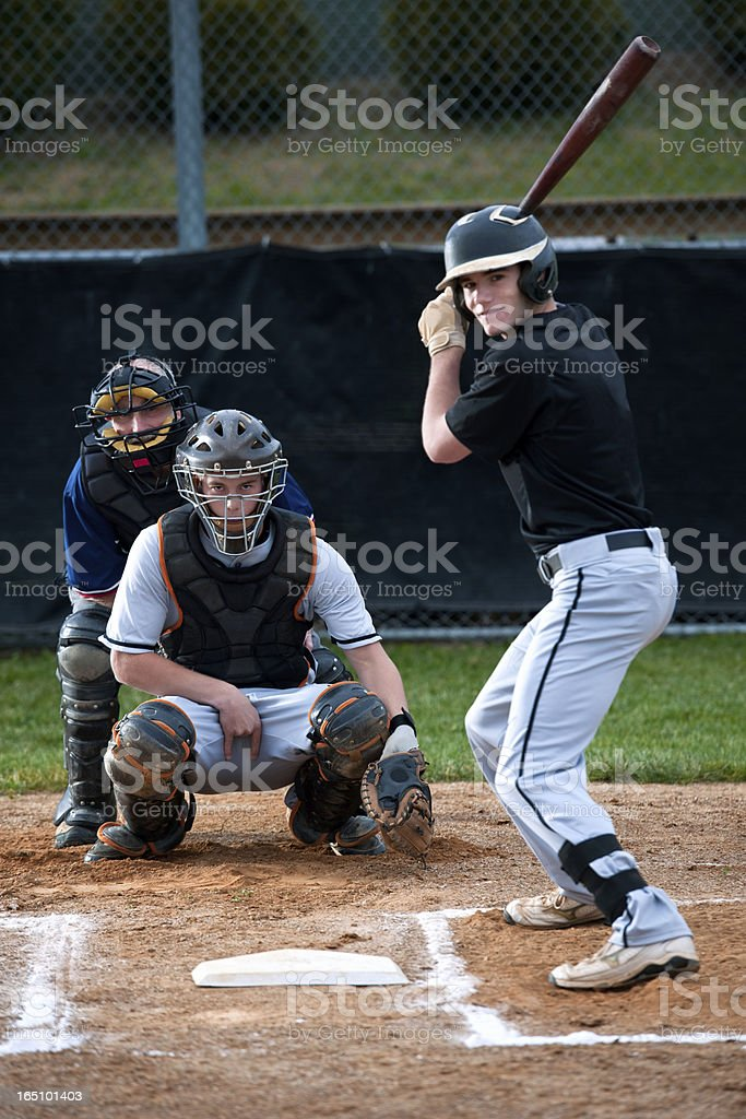 Baseball catcher calling the pitch with hand sign stock photo