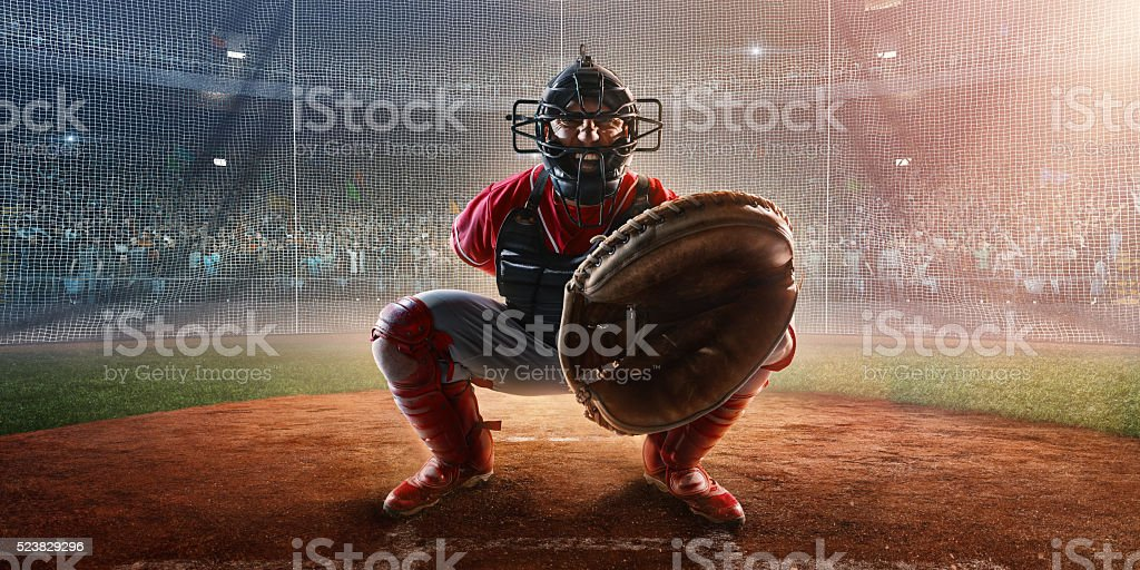 Baseball catcher on stadium stock photo