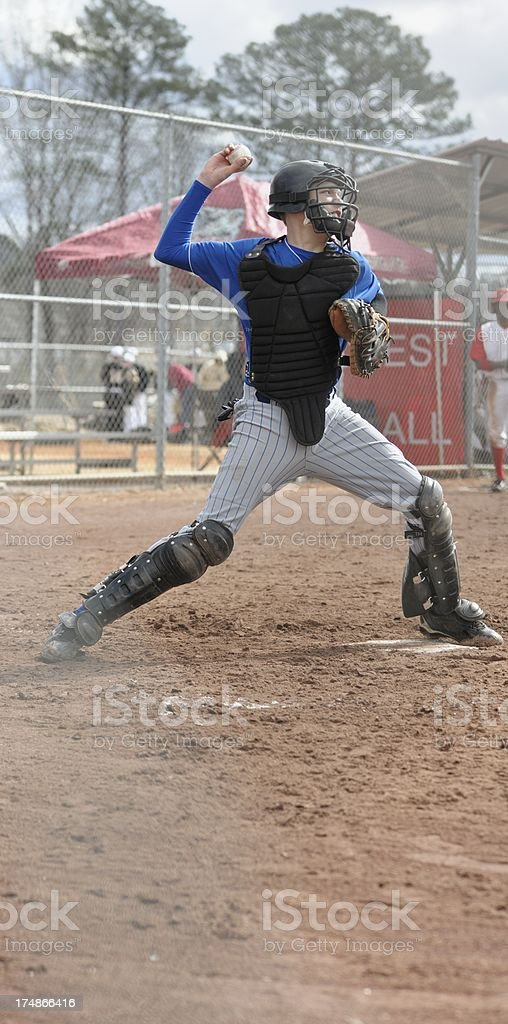 Baseball catcher throwing down to second royalty-free stock photo