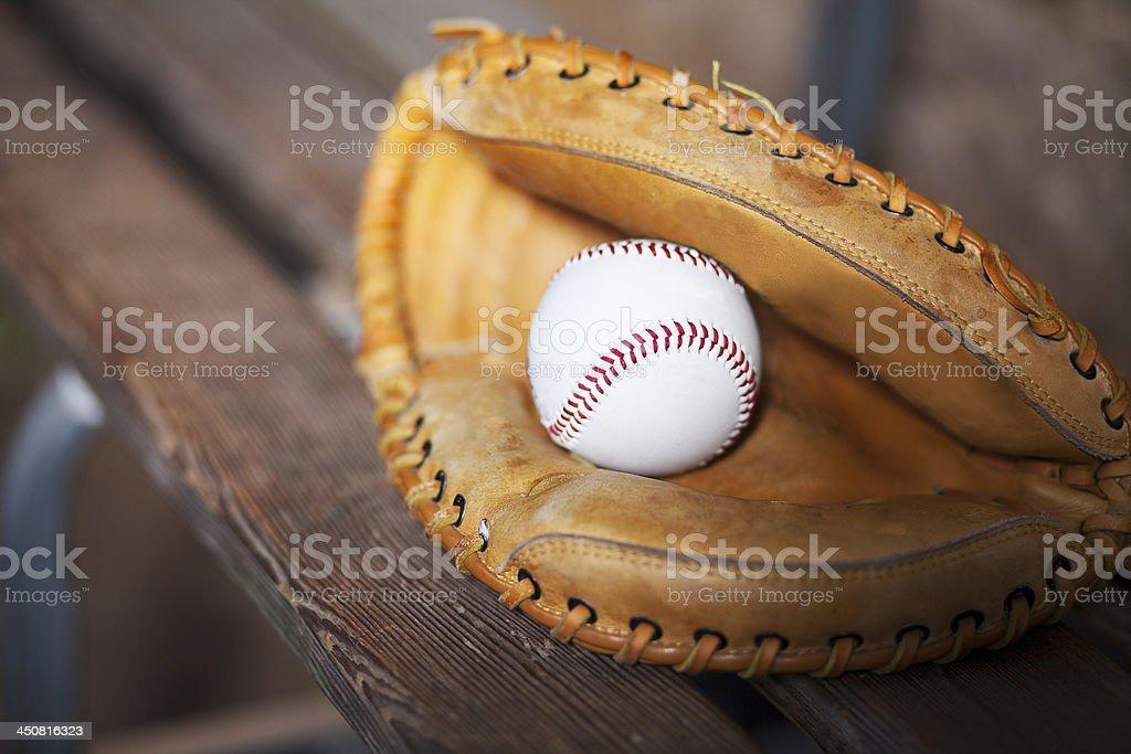 Baseball Catchers Glove on Bench Still Life stock photo