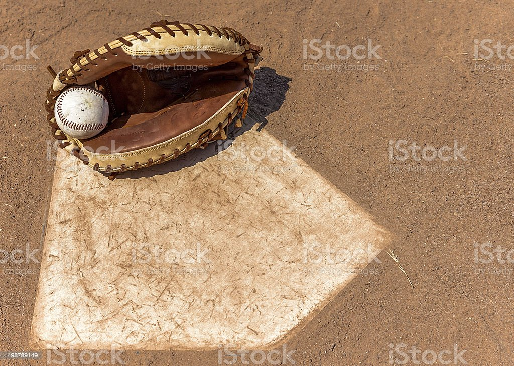 Baseball Catcher's Mitt at Home Base stock photo