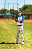 Baseball Coach with Arms Crossed