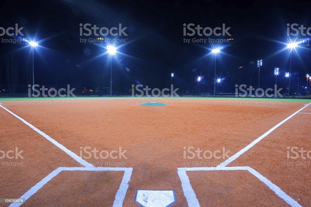 Baseball diamond at night stock photo