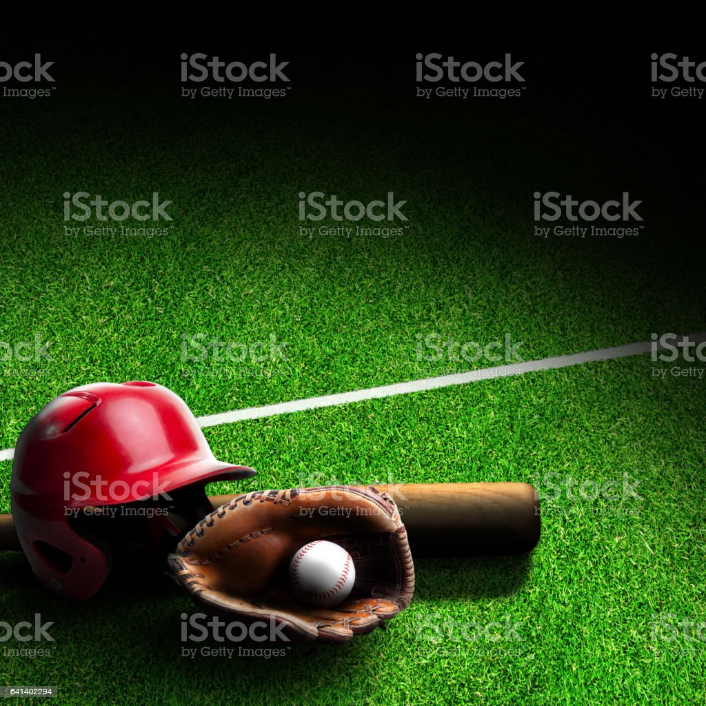 Baseball Equipment on Field With Copy Space stock photo