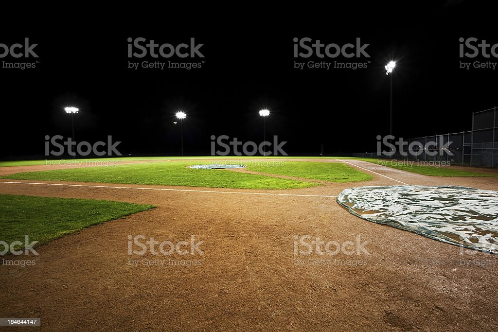 Baseball field highlighted empty with rain delay for game stock photo