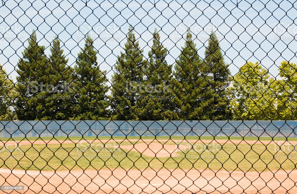Baseball Field Through Fence stock photo