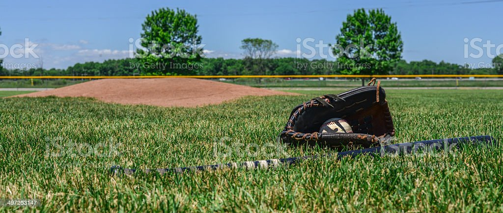 Baseball Field with Glove, Ball and Bat stock photo