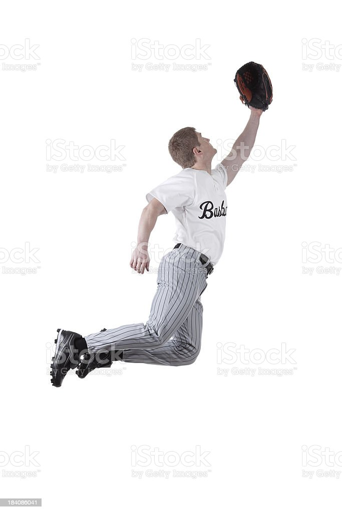 Baseball fielder jumping to catch the ball royalty-free stock photo