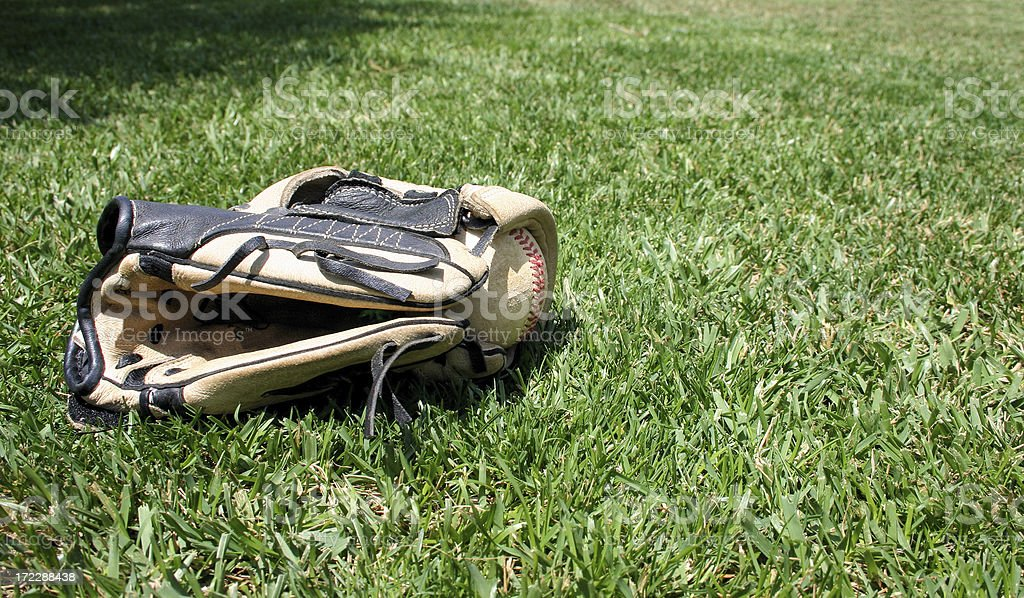 Baseball glove and ball stock photo