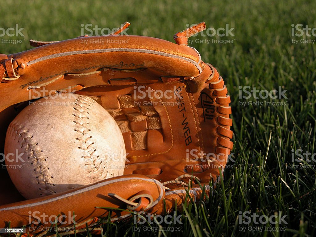 Baseball Glove Holding Softball stock photo