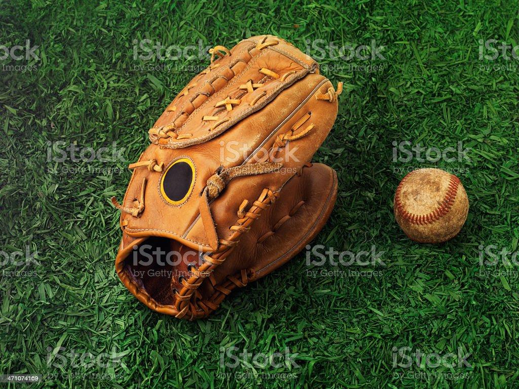 Baseball glove on grass royalty-free stock photo