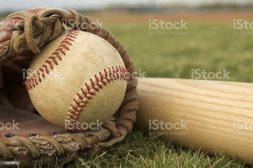 Baseball in a Glove near Bat stock photo