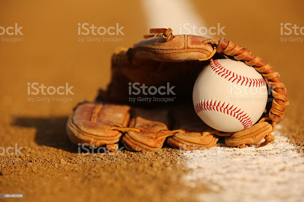 Baseball in a Glove on the Infield stock photo