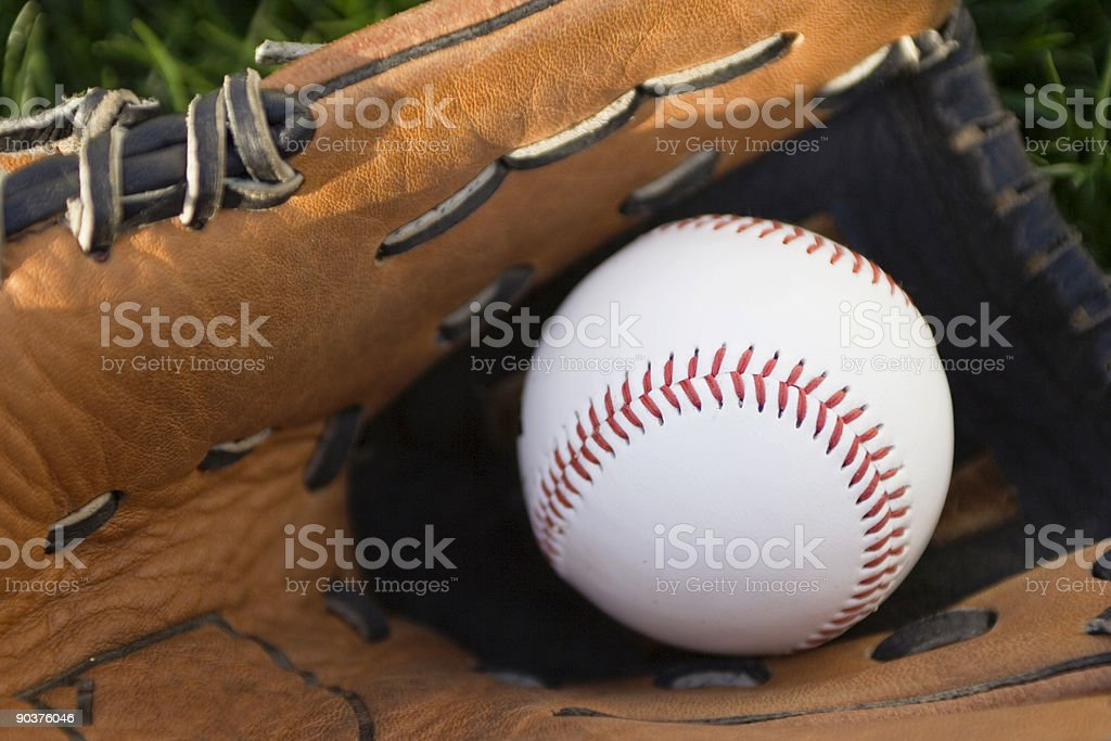 baseball in a glove royalty-free stock photo