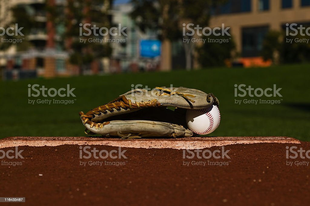 Baseball in glove on the field stock photo