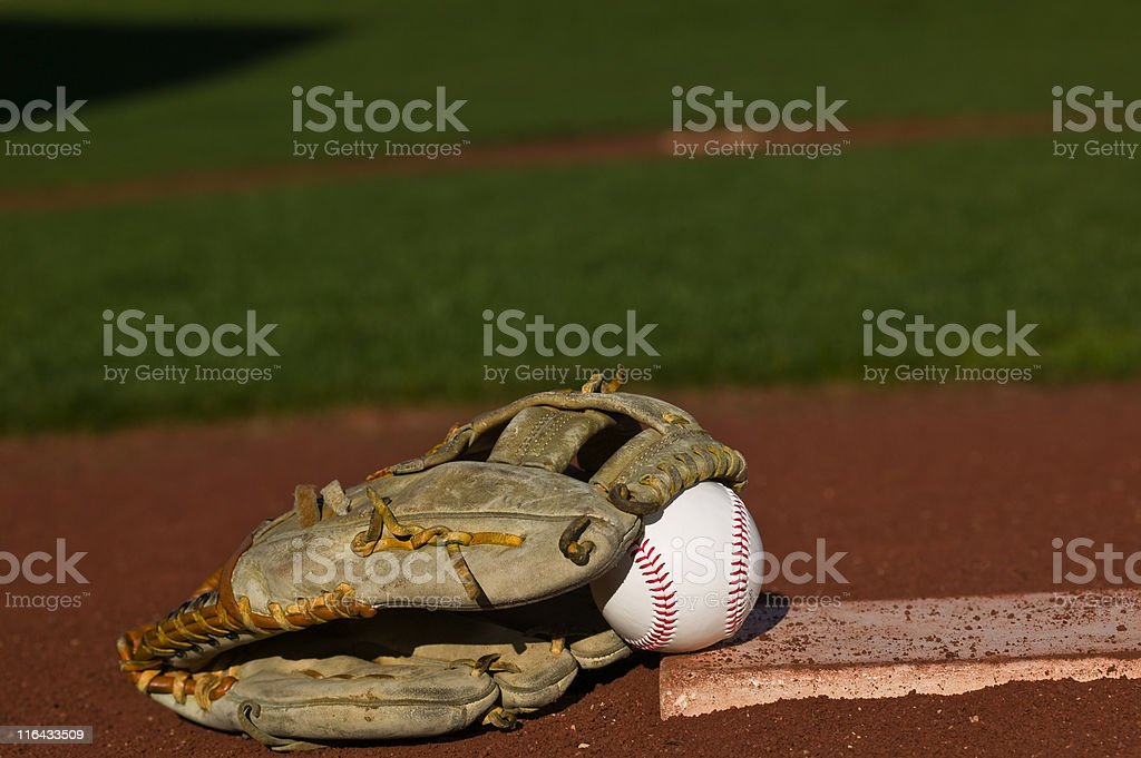 Baseball in glove on the field royalty-free stock photo