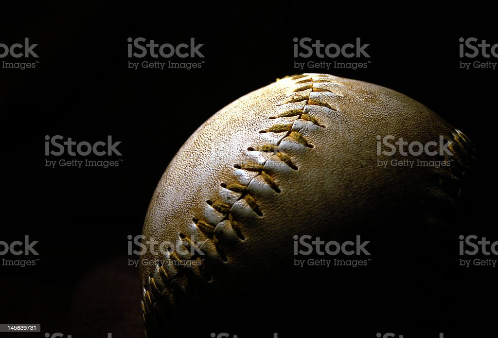 Baseball in spotlight stock photo