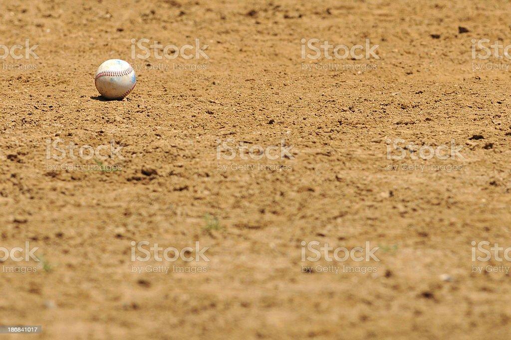 Baseball in the dirt stock photo