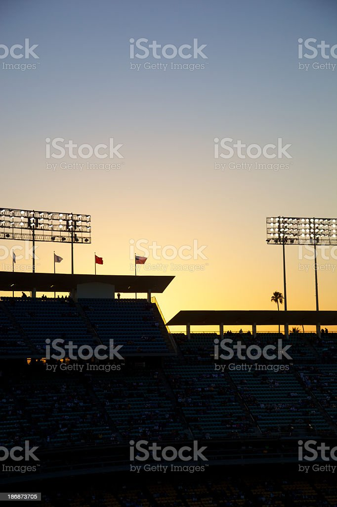 Baseball Lights at Sunset with Crowd stock photo