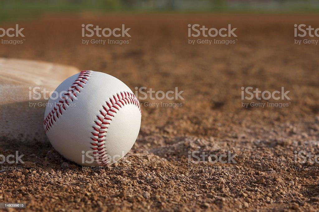 Baseball near a Base stock photo