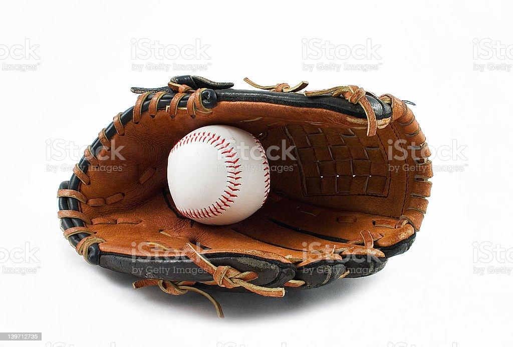 Baseball nestled inside glove isolated on white background stock photo