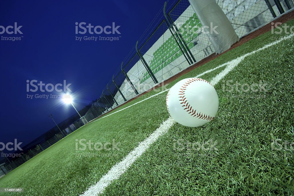 Baseball on grass at night stock photo