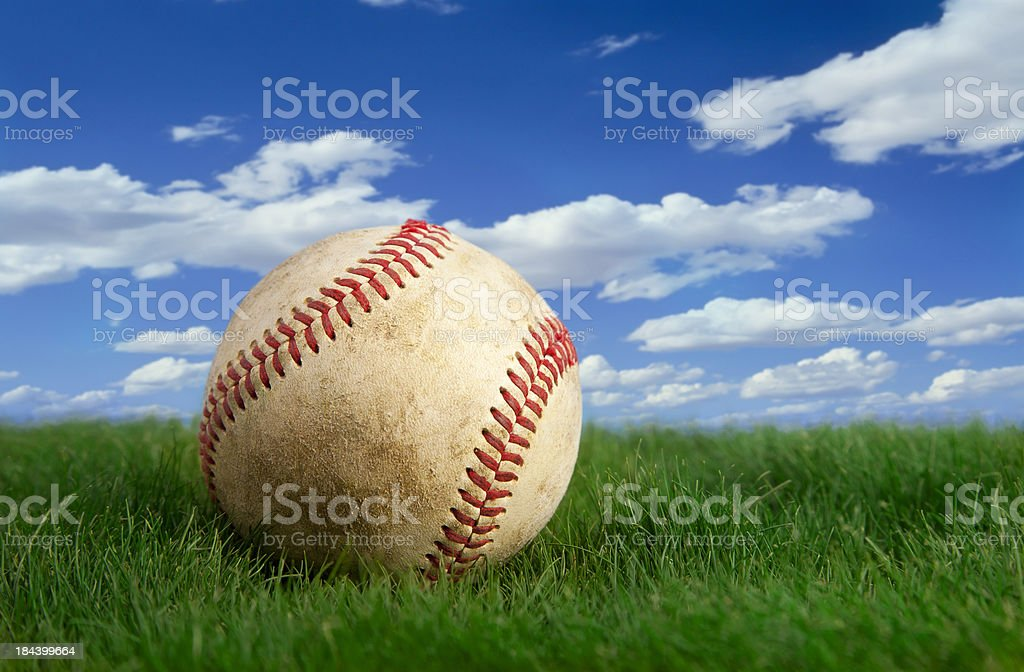 Baseball on Grass with sky background royalty-free stock photo