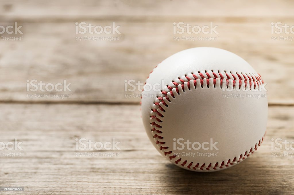baseball on old brown and vintage table background stock photo